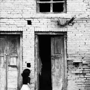 Girl standing in front of door