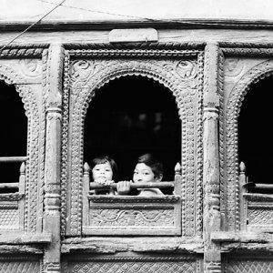 Kids sitting by window
