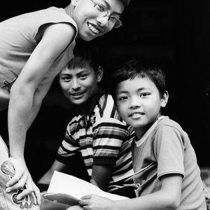 Three boys doing homework together