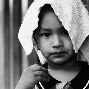 Boy putting towel on head
