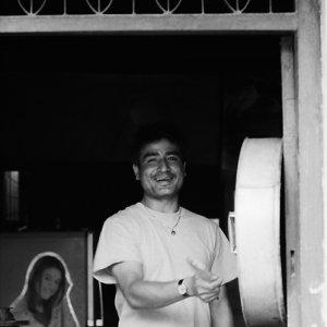 Man cooking Momo