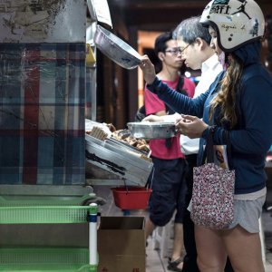 Woman coming to food stall