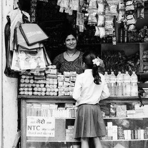 Female storekeeper in general store