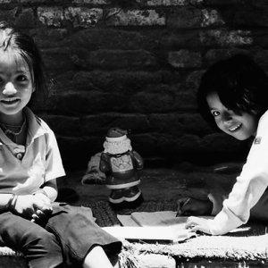 Girls doing homework by wayside