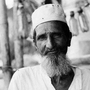 Man wearing white beard and white cap
