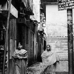 Two women at entrance of lane
