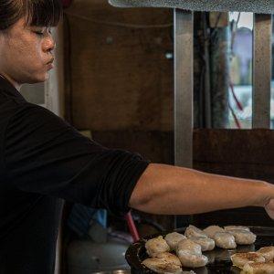 Woman cooking radish cake