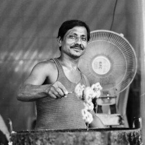 Man frying sweets