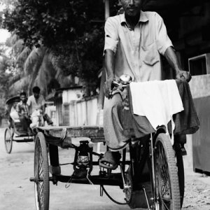 Man riding tricycle