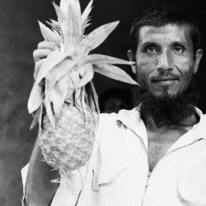 Man holding pineapple