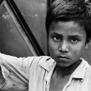 Boy watching with displeased eye