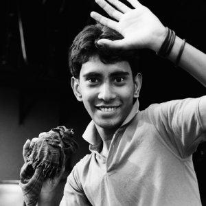 Young man raising hand