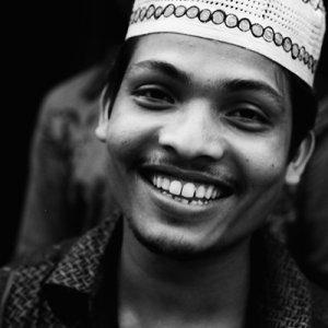 Man wearing patterned Taqiyah