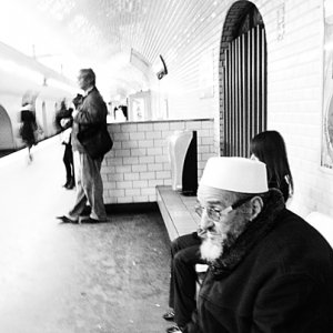 Old man waiting for train