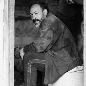 Man sitting on bag
