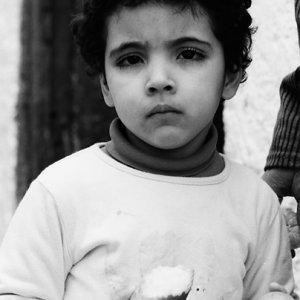Kid having bread and orange