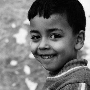Boy giving grin