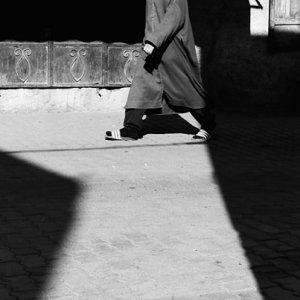 Man wearing jellaba walking