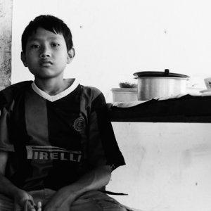 Boy wearing football shirt