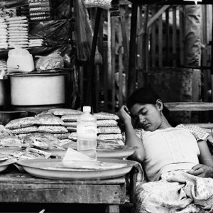 Woman sleeping in storefront