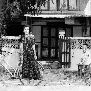 Girl, boy and bicycle