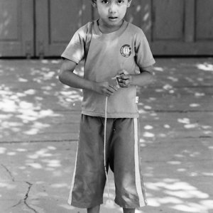 Boy holding spinning top