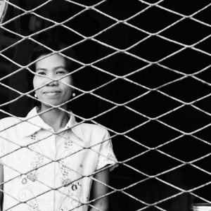 Woman on other side of wire netting