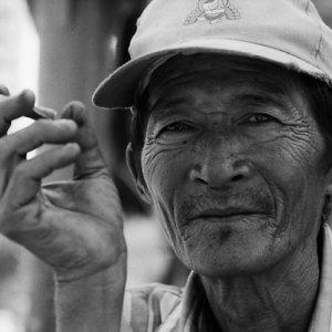 Man puffing cigar