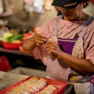 Woman making dumplings in Yamuliao Market