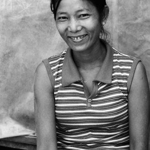 Woman smiling inwardly