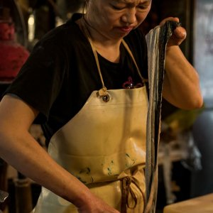 Woman cooking eel
