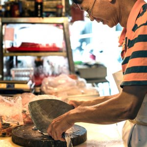 Fishmonger holding unusual type of kitchen knife