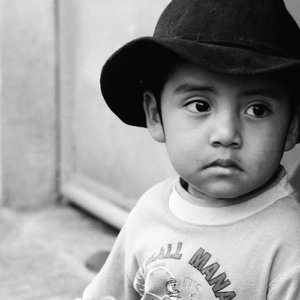 Boy wearing black cowboy hat