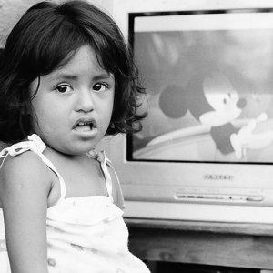 Girl watching animated Disney movie