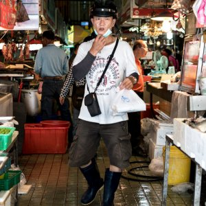Man carrying plastic bag