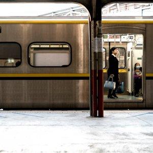 Woman in train car