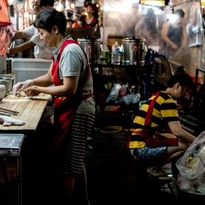 woman cooking in food stall