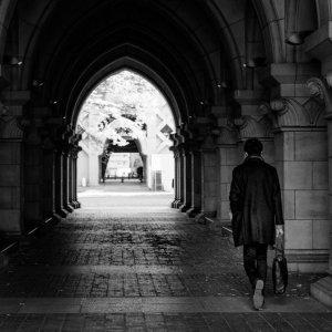 Man going through arch