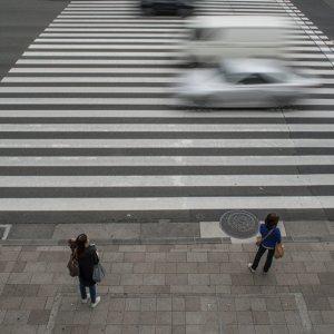 Three women at stoplight