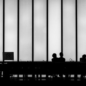 Silhouettes in cafe