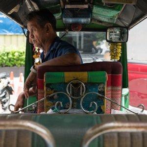 Tuk-tuk driver with rough look
