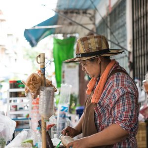 Hatted woman in food stall