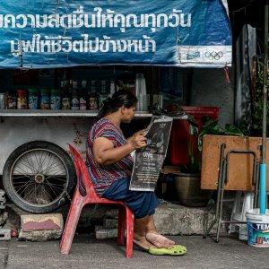 Women reading newspaper
