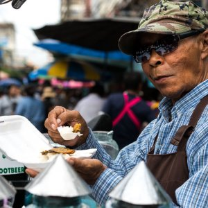 Street vendor having lunch