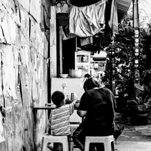 Parent and child in eating place
