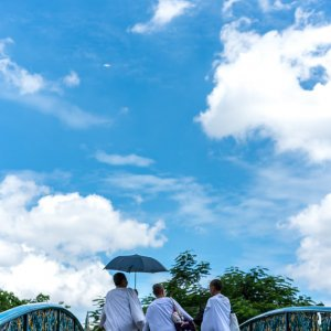 Three nuns on bridge