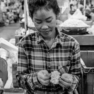 Woman making flowerage by hand