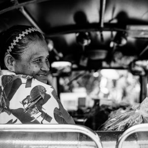 Older woman smiling in Tuktuk