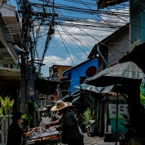Stall in narrow lane with many electric wires
