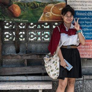 Girl throwing deuce in a bus stop